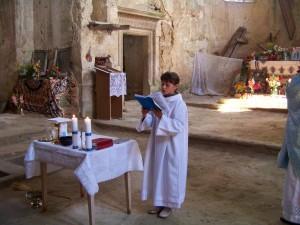 Altar Boy reading during Mass