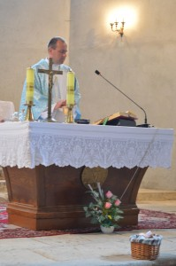 Fr. Andrew celebrating Mass, feast of the Assumption