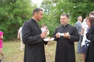 Assisting Clergy enjoying lunch.